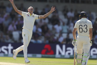 Josh Hazlewood celebrates after taking the wicket of Jos Buttler.