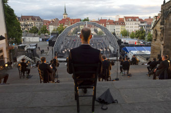 Singers sit apart for a rehearsal of the Cathedral Steps open air festival in front of Mariendom (Cathedral of Mary) and St Severi's Church in Erfurt, Germany, last week.