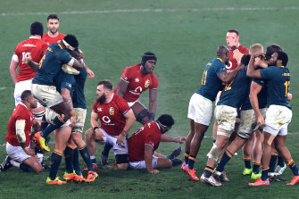 Lions and Springbok players after the final whistle.