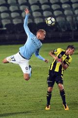 Nathaniel Atkinson flies for City.