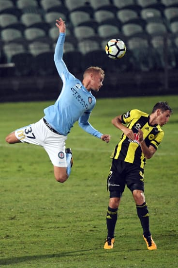 Nathaniel Atkinson flies for City.