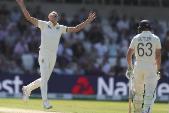Josh Hazlewood celebrates after taking the wicket of Jos Buttler.