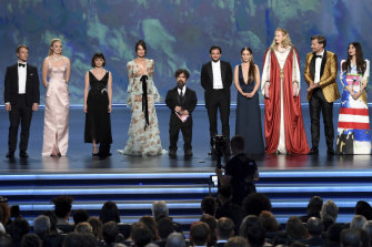 Fashionable gang ... The Game of Thrones cast on stage at the Emmys.