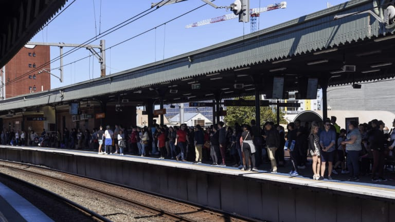 Travellers wait for trains at Strathfield station on Saturday afternoon.