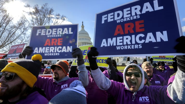 Federal employees rally at the Capitol to protest against the impasse between Congress and President Donald Trump over his demand to fund a US-Mexico border wall.