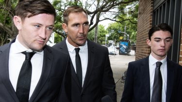 North Queensland Cowboys player Scott Bolton (centre) entering Waverley Court.