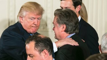 US President Donald Trump congratulates Steve Bannon, his then chief strategist, last year. Bannon is a former backer and vice-president of Cambridge Analytica.