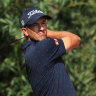 Scott crashes at Shanghai as McIlroy leads