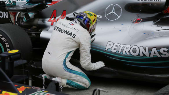 Lewis Hamilton wins in Brazil as Mercedes take fifth F1 title