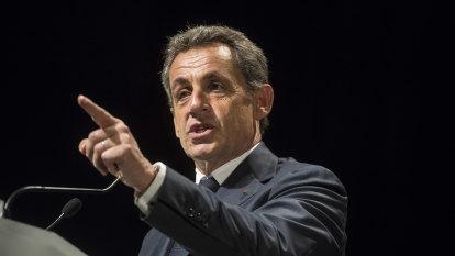 France's Sarkozy in dock in historic 'burner phone' corruption trial