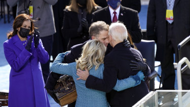 US President Joe Biden hugs first lady Jill Biden, his son Hunter Biden and daughter Ashley Biden after being sworn-in during the 59th Presidential Inauguration at the US Capitol in Washington.