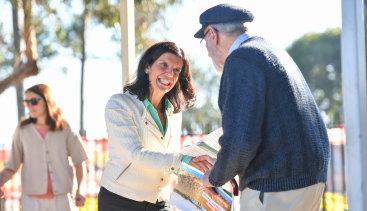 Julia Banks, independentcandidatefor Flinders,hands out how to vote cards at Osborne Primary School in Mount Martha.