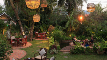 Dine under a canopy of trees and hanging lanterns at 3 Nagas.