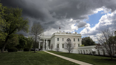Storm clouds gather above the White House in Washington.