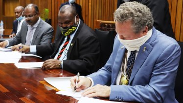 PNG Prime Minister James Marape and Andrew 'Twiggy' Forrest signing an agreement in Port Morseby in September on one of the first legs of his world tour.