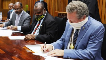 PNG Prime Minister James Marape and Andrew 'Twiggy' Forrest signing an agreement in Port Morseby.