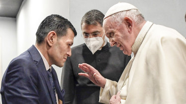 Pope Francis speaks to Abdullah Kurdi, left, father of Alan Kurdi, a 3-year old Syrian boy who's image made headlines after he drowned in the Mediterranean Sea and drew global attention to Europe's refugee crisis.