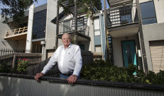 Commercial builder Bill Dumbleton in front of his Yarraville townhouse.