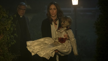 Vera Farmiga (centre) with the possessed doll in Annabelle Comes Home.