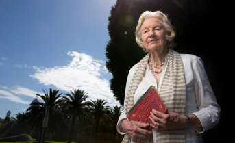 Elvala Ayton, at Melbourne's Shrine of Remembrance, with one of five notebooks of her father-in-law Philip Owen Ayton's WWI diary.
