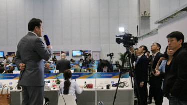 A reporter from China Global Television Network gets ready for the opening ceremony of Belt and Road Forum last year.