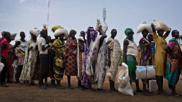 Women who fled fighting in nearby Leer in recent months, queue for food aid at a food distribution made by the World Food Program in Bentiu in 2016.