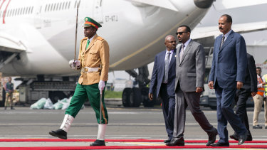 Eritrean President Isaias Afwerki, right is welcomed by Ethiopia's Prime Minister Abiy Ahmed, second right upon his arrival at Addis Ababa International Airport, Ethiopia, on Saturday.