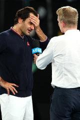 Jim Courier interviews Roger Federer at the Australian Open.