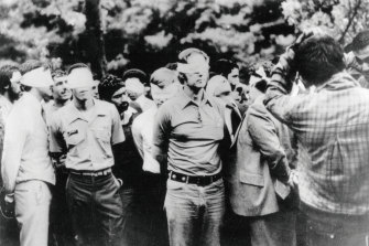 The first day of occupation of the US embassy in Tehran in 1973 shows US hostages being paraded by their militant Iranian captors.