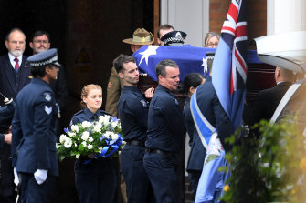 Colleagues serve as pallbearers as Constable Humphris' funeral.