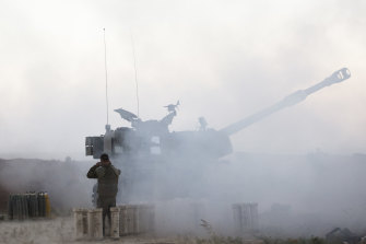 An Israeli soldier operates an artillery unit as it fires near the border between Israel and the Gaza Strip on May 18, 2021 in Sderot, Israel.