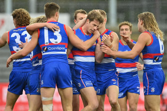 Mitch Hannan is congratulated by his teammates.