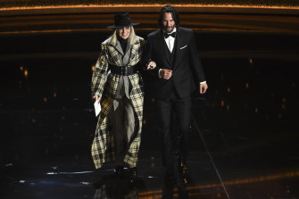 Diane Keaton, left, and Keanu Reeves appear on stage at the Oscars.