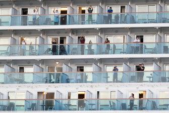 Those still onboard wave goodbye.