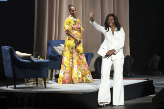 Former first lady Michelle Obama and Tracee Ellis Ross in California during her 2018 'Becoming' book tour. Michelle wore a custom Christian Siriano suit .