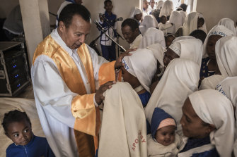 Andre Christian Dieudonne Mailhol, the founder of the Church of the Apocalypse, with followers in Ankazobe, Madagascar, in late May 2019.