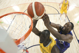 Duop Reath (left) battles USA's Bam Adebayo in the Olympics warm-up match this week.