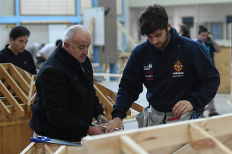 A master and apprentice carpenter at Holmesglen TAFE Chadstone campus in 2017.