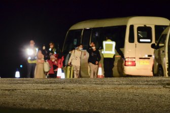 Australian passengers evacuated from Wuhan, China, arrive on Christmas Island Monday night.