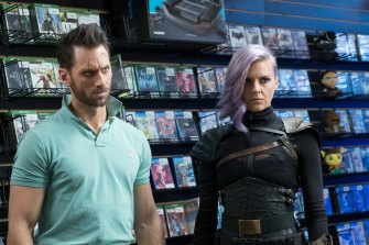 Wolf (Derek Wilson) and Tiger (Eliza Coupe) try to blend in Future Man.
