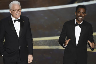 Best non-hosts: Steve Martin, left, and Chris Rock speak at the Oscars.