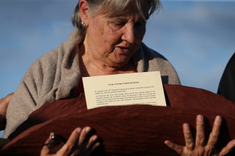 Pat Anderson from the Referendum Council with a piti holding the Uluru Statement from the Heart in May 2017.