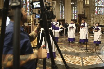 Members of St Andrew's Cathedral  choir record their Christmas service, which will be now be an online event because of the restrictions relating to COVID-19.