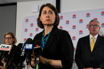 NSW Premier Gladys Berejiklian, flanked by Chief Health Officer Kerry Chant and Health Minister Brad Hazzard, at a press conference on Friday.