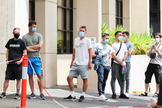 The waiting game ... people associated with the Australian Open line up at a testing facility on Thursday. We must also be patient for proof before demanding any treatments.