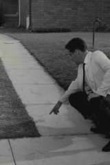 Investigator points to footprints believed to belong to the Kingsgrove Slasher, February 18, 1959.