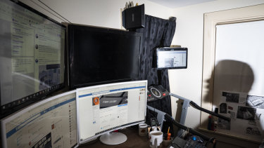 Christopher Blair, 46, sits at his desk at home in Maine and checks his Facebook page, America's Last Line of Defense.