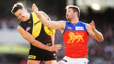 Copping a spray: Ivan Soldo sweats it out for Richmond against Brisbane's Stefan Martin.