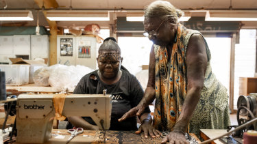 Tiwi Islands woman Lucia Pilakui, who has been involved with Bima Wear for 50 years, training Tamsin Kantilla.