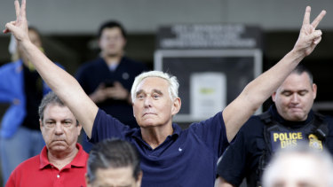 Roger Stone mimicked a Richard Nixon pose as he left a Florida court on bail.